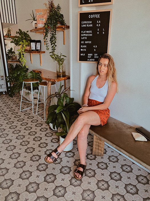 Female model posing for a portrait photo in a cafe