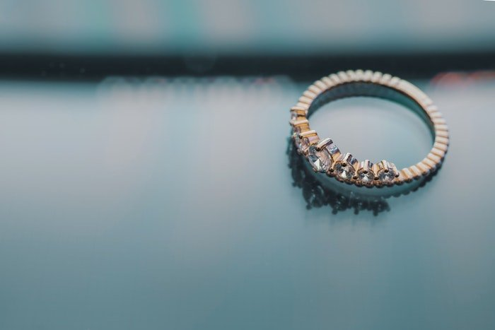 A diamond ring on a smooth background
