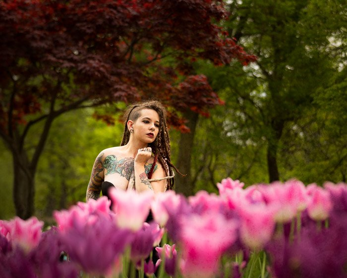 Photo of a woman on a field of pink tulips -shallow depth of field