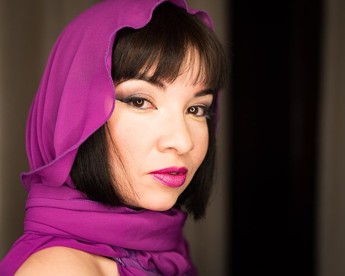 Portrait of a woman with a purple headscarf with shallow depth of field