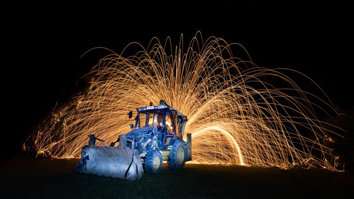 steel wool photography with a tractor in the foreground