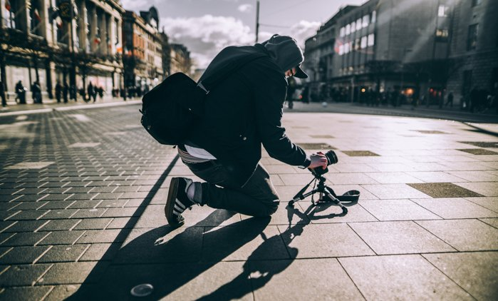 A street photographer shooting from a low angle