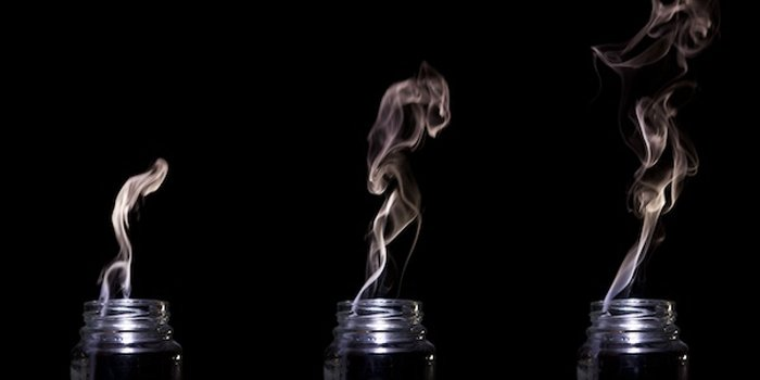 Triptych of smoke coming out of a glass jar