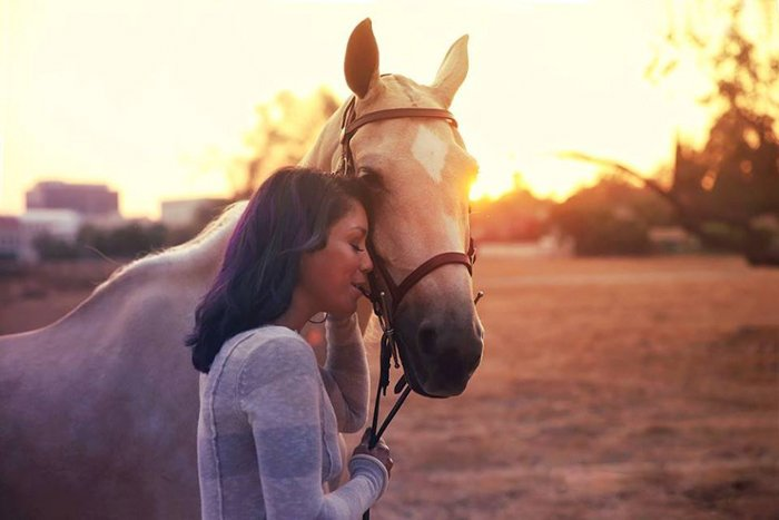 Dreamy portrait of a woman and a horse