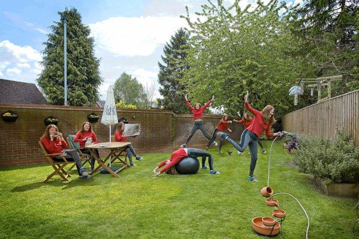 A multiplicity photo of a cloned woman danced around a garden