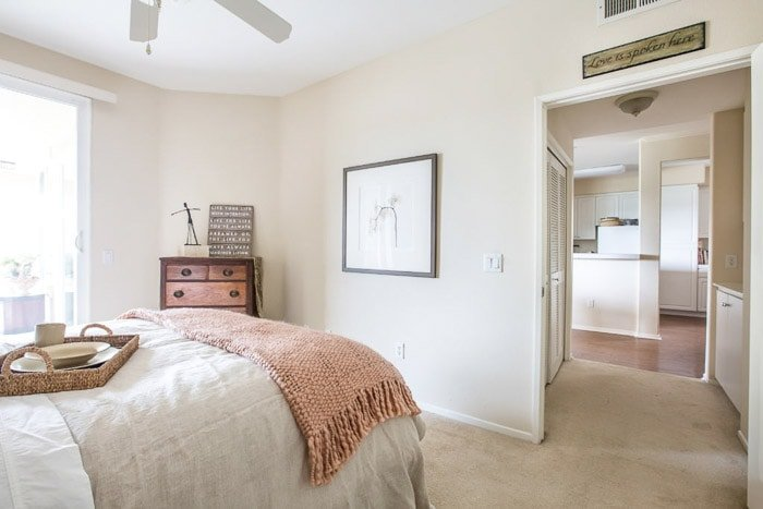 photo of the inside of a bedroom with pastel colors
