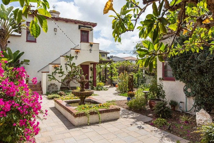photo of a mediterranean style garden with flowers and trees