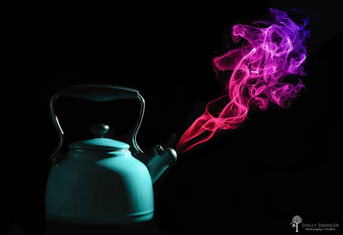 photo of a tea pot with purple smoke coming out of it
