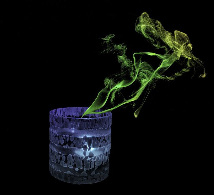 photo of a candle with green smoke