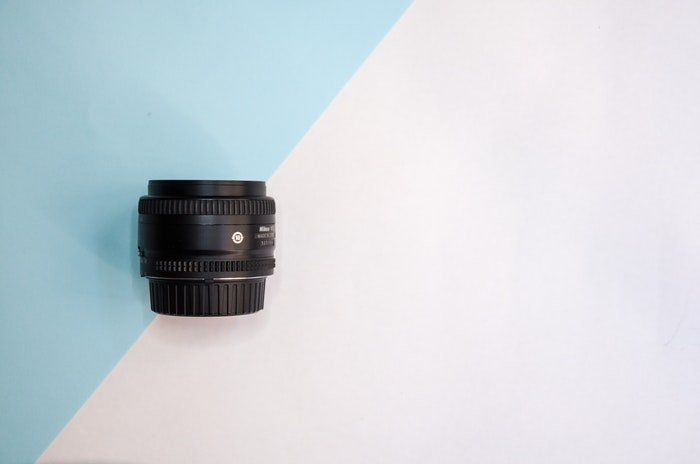Zoom lens on a pastel background