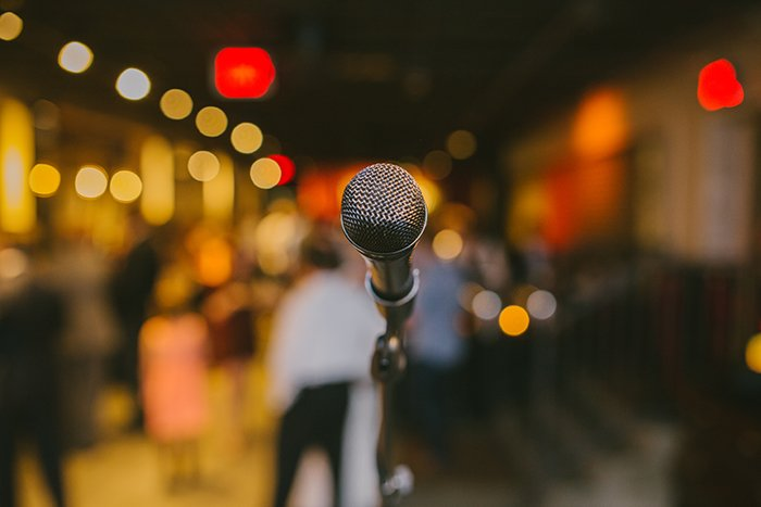 Bokeh lights behind a microphone.