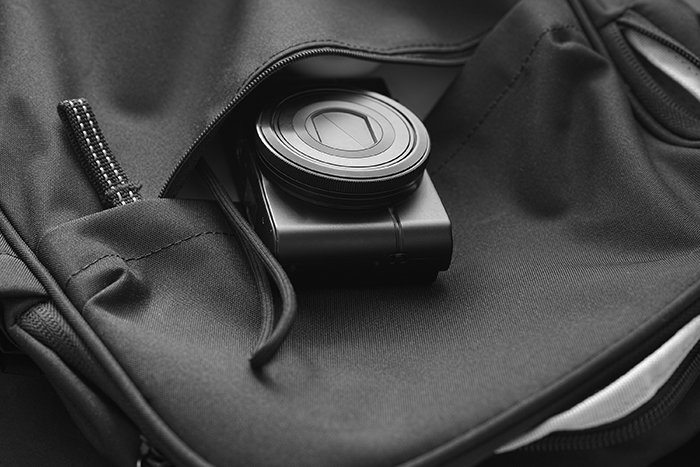 Compact camera in a backpack.