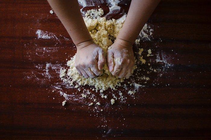 Overhead shot of hands kneading dough