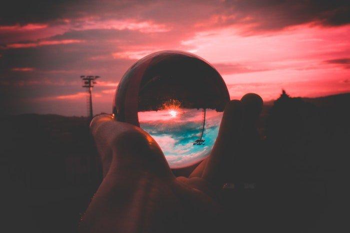 A pink sunset shot through a lensball