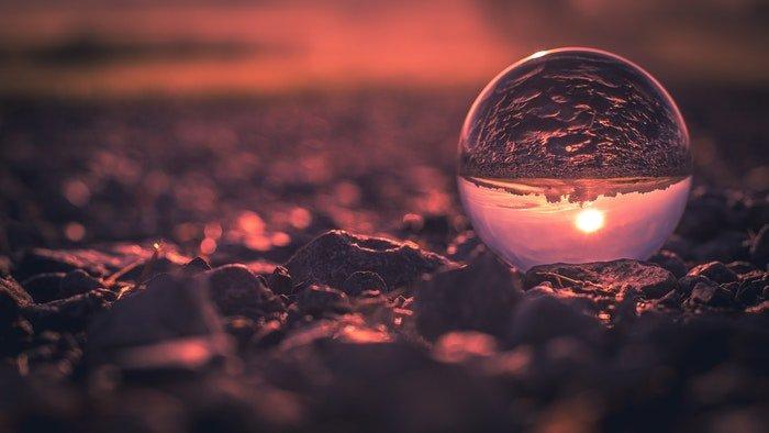 A beach sunset shot through a lensball