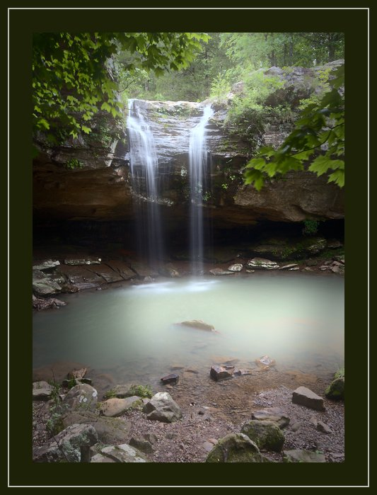 A beautiful flowing waterfall photo with green border