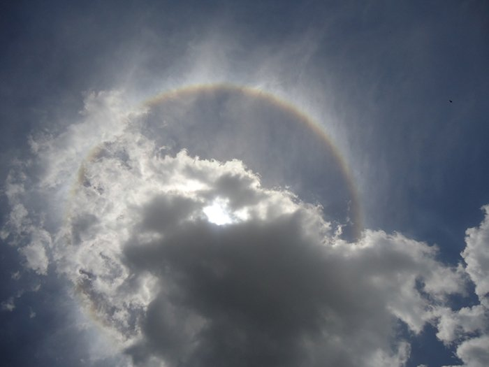 clouds obscure a solar eclipse
