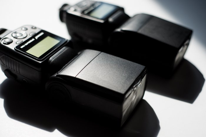 Two external camera flashes