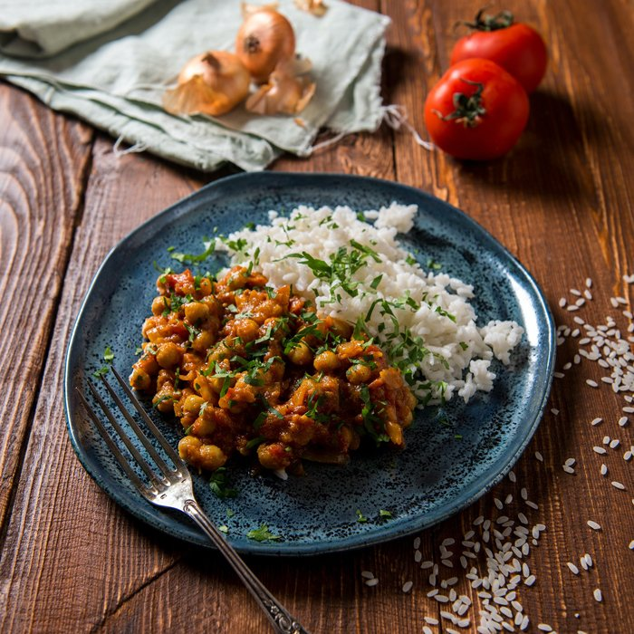 Indian food photography of a tasty curry on a blue plate