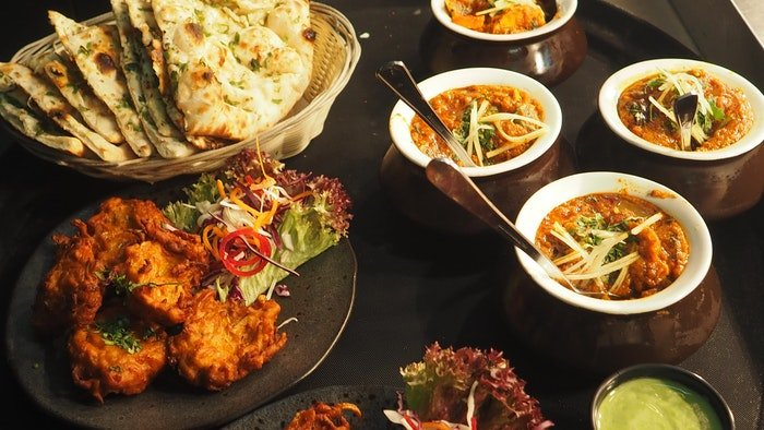 Indian food laid out on a table