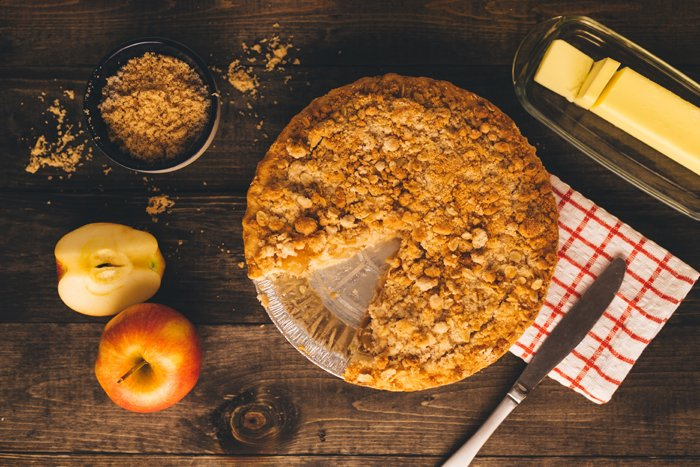 Overhead shot of apple pie on a wooden table