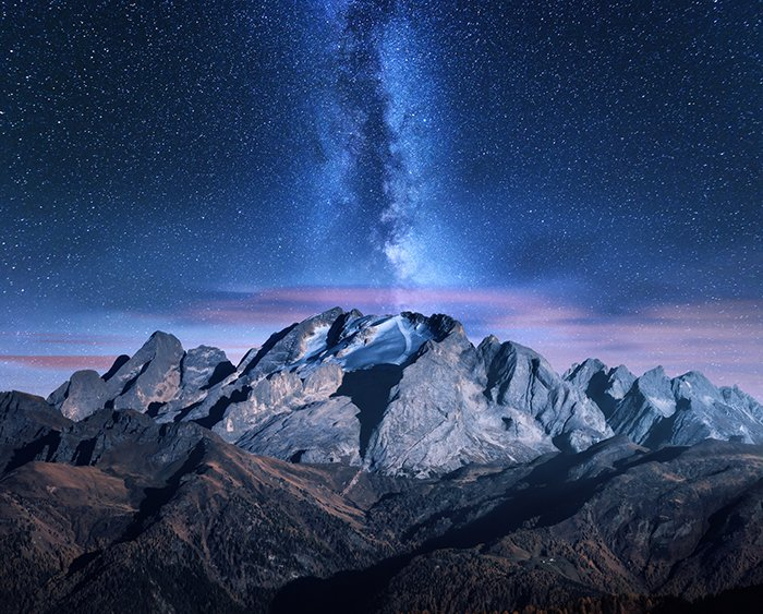 Milky Way and mountains at starry night in autumn.