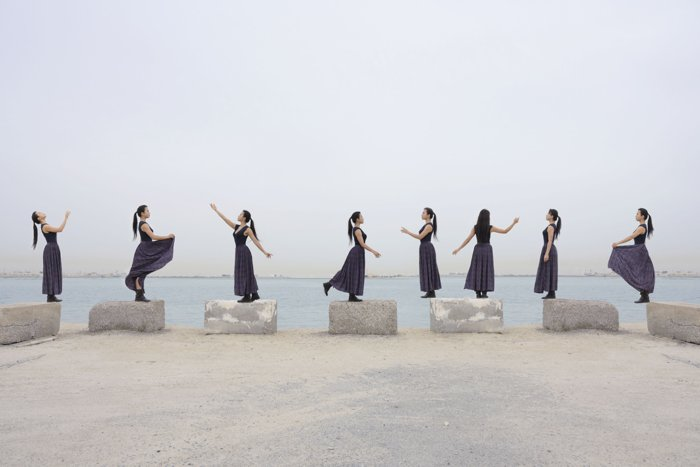 A multiplicity photo of a cloned woman danced around a beach