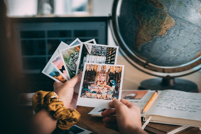 A girl looking through photos from her travels