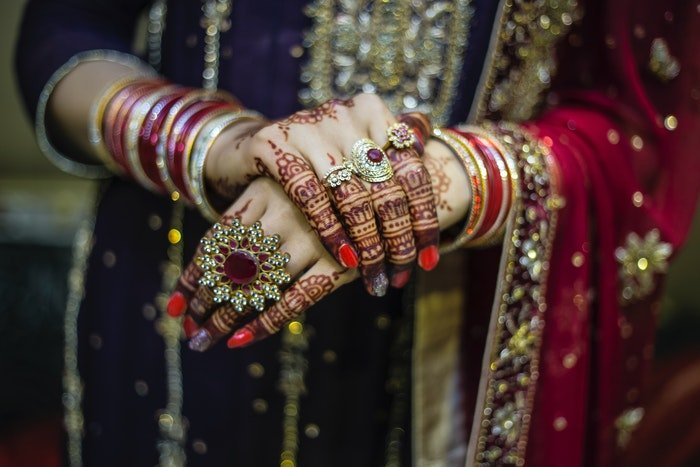 Close up of an Indian bride getting ready for her wedding