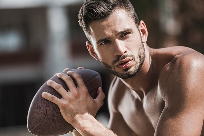 Portrait of young male football player with strong jawline.