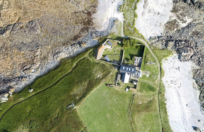 Aerial photo of a large house and surrounding nature