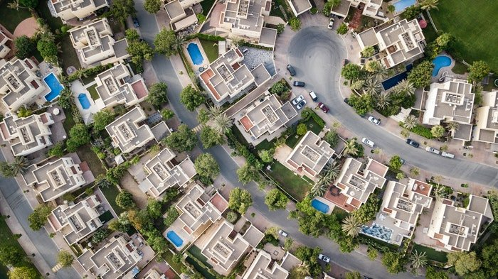 drone photo of a neighborhood of consisting of villas