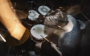 photo of a drummer with sloy sync flash