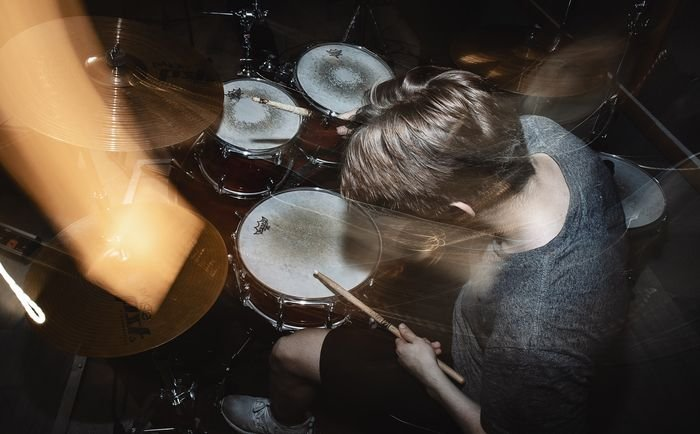 photo of a drummer with slow sync flash
