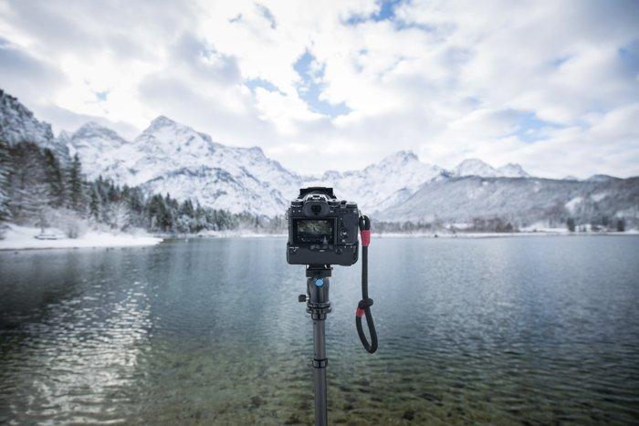 A DSLRon tripod shooting an icy landscape time-lapse