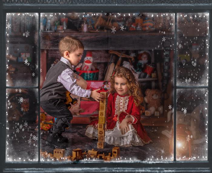 Kids playing through a windowsill by Sonia Gourlie