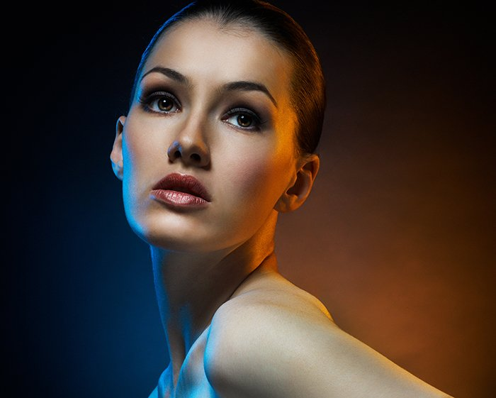 Beauty portrait of a model with two colorful fill lights.