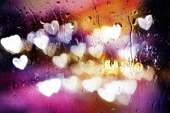 Custom bokeh blur with heart behind a wet window.