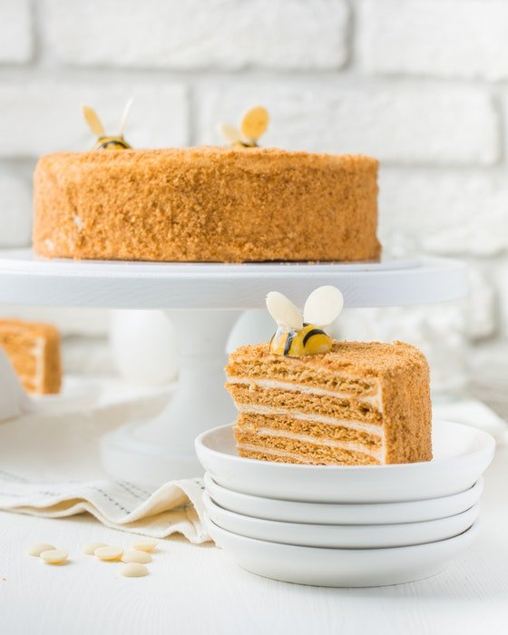 Bright and airy photo of a delicious cake on white plates