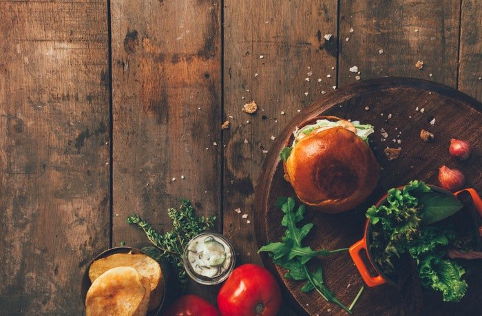 Food photography of hamburger and ingredients on a DIY background