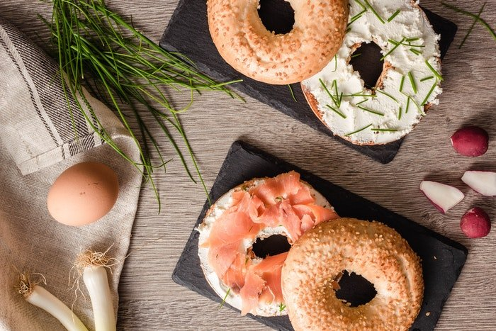 Flat lay food photo of salmon bagels and other ingredients