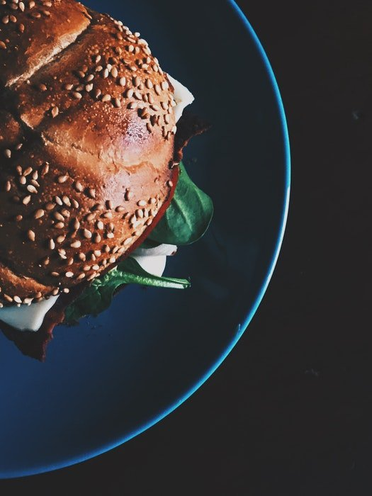 Flat lay food photo of a burger on a plate