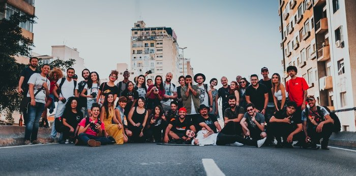 A large group photo outdoors