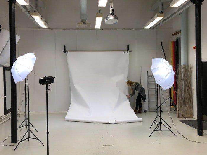 A photographer setting up a studio