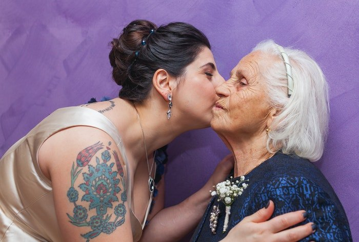 juxtaposition of a tattooed lady and her grandmother