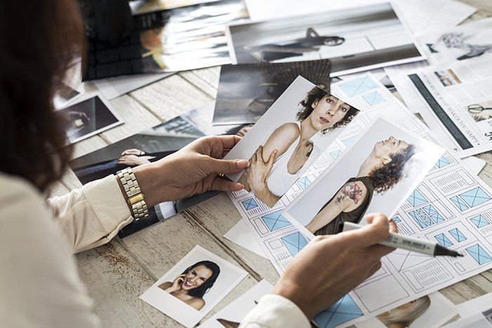 Photographer selecting models.