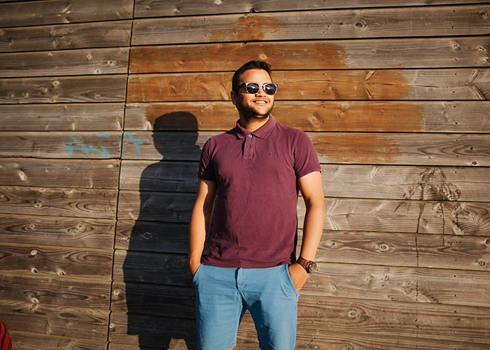 A man posing for a photographer
