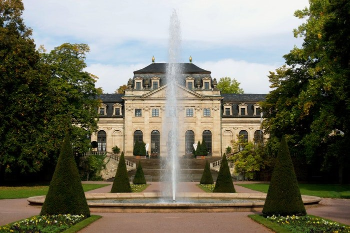 Exterior of a lavish property with fountain