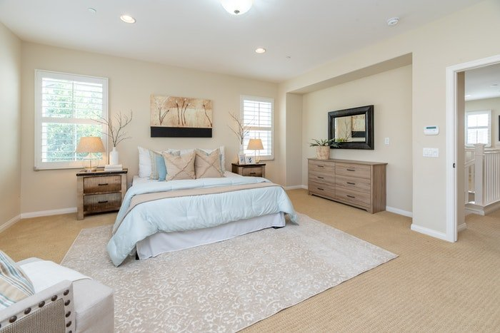 Real estate photo of the interior of a lavish bedroom