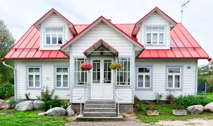 Exterior of a pretty white and red house